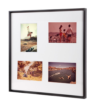 Family photographs framed in a multi aperture photo frame from Nielsen.
