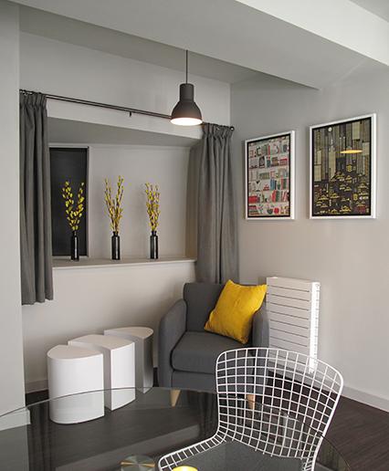 a lovely modern living room with framed artwork